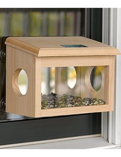 Mirrored Window Birdfeeder I LOVE watching birds through the window while sipping coffee and reading the paper