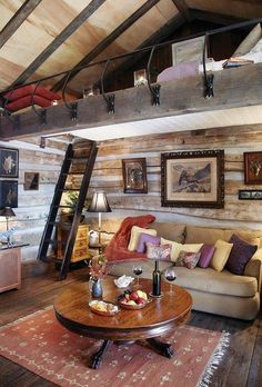 Sleeping lofts are a great way to maximise space. I really like this cabin with it's one legged ladder but I don't know that I think much of that 'safety rail'. Do you like it? Not the rail, silly - the cabin and sleeping loft!