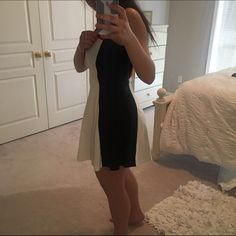 Express fit and flare tank dress Only worn once! This express fit and flare dress gives off an hourglass shape with the red, off-white and black colors. Express Dresses Mini