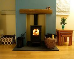 An idea to liven up my parents' lounge fireplace, with a wood beam and a coloured feature wall.
