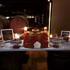 Wine barrels, cake stands, candles, flowers, and personalized signs Layer Cheesecake, Wine Barrels, Cake Stands, Wedding Desserts, Personalized Signs, Dessert Table, Table Settings, Candles, Traditional