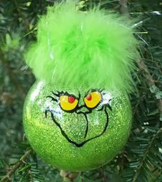 The Grinch DIY Christmas Ornament 27 Spectacularly Easy DIY Christmas Tree…DIY grinch ornament Theme: Storybook Christmas, Childhood story Christmas, etc.GRINCH ORNAMENT Just because there's not snow on the ground, doesn't mean Christmas can't be celebr Diy Christmas Tree Ornaments, Grinch Ornaments, Noel Christmas, Christmas Bulbs, Diy Ornaments, Glitter Ornaments, Homemade Ornaments, Glass Ornaments, Decorating Ornaments
