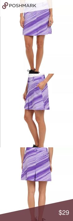"""NWT Nike Golf Purple Striped Skort 2 pcs Nike Golf Speed Stripe  Skort Size 8 NWT  Dri-FIT material wicks moisture away from the skin to keep you comfortable during play.  Detachable interior compression shorts for superior coverage.  85% polyester, 15% spandex;Inner short:  87% polyester, 13% spandex;  Gusset lining: 10% polyester  Retails for $85  16.5"""" across the top of the elastic waist  and the total length is 17.5 """"  The rise measures 11"""" and the inseam is 6"""".    Bundle with two other…"""