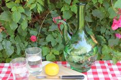 Vintage Midcentury Green Glass Carafe Wine Server Cooler. $18.00, via Etsy.