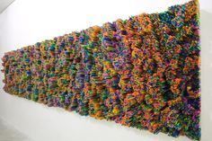Italian artist Francesca Pasquali uses everyday drinking straws to create amazing three-dimensional art installations. The colorful plastic materials are cut to varying lengths and arranged in patterns that viewers will want to reach out and touch. Collectively, the single little straws form a massive synthetic landscape filled with peaks and valleys.