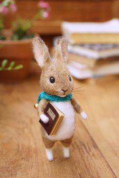 Needle felted wild rabbit with a book