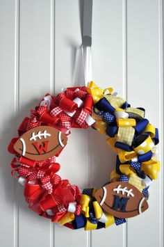House divided team spirit ribbon wreath- you choose the colors/teams.  I am thinking University of Kentucky and University of Michigan.  We never play each other but it represents our household.