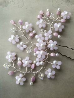 Cherry blossom pink crystal white pearl Spring wedding bridal spray hair bun pin accessory. Spring cherry blossom was the inspiration for this lovely hair pin handmade with the palest pink opal crystals, clear crystals, pink Czech pinch beads and snow white Czech faux glass