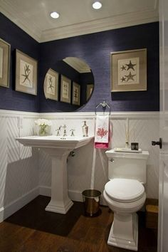 navy blue grass cloth is so appealing when mixed with white wainscoting