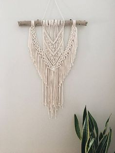 This wall hanging is guaranteed to give your home character. Whether its for you or youre giving it as a gift, this handmade piece is one of a kind and is sure to be a unique addition to a home! You can order an optional ombre dip dye to give it a pop of color. Macrame Wall Hanging