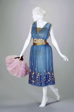 A blue silk evening dress from 1921 at the V&A Museum.