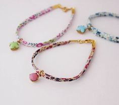 Vintage friendship bracelets - Beadin' Nora - notonthehighstreet  I love this floral Liberty fabric cord, and would use a gemstone bead or cabochon as the charm...