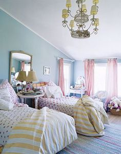 love the yellow stripe bedding with the pink accents and blue walls