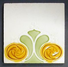 """Craven Dunnill and Co relief moulded dust pressed tile with the top part of a two tile Art Nouveau formalised floral design, polychrome, 6"""" square, c1905"""