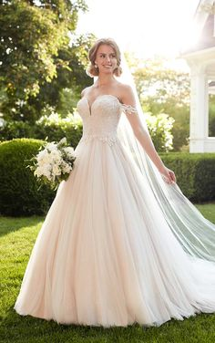 A dreamy ballgown for a total princess moment, this decadent beaded bridal style from Martina Liana is completely swoon-worthy!