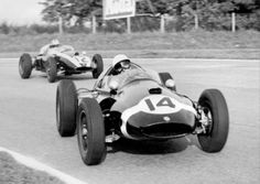 British driver Stirling Moss on Cooper Cimax (number 14) is seen in ...