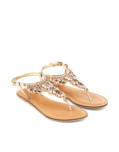 Stand out in the sunshine with our embellished sandals, decorated with chunky jewels and sparkling crystal gems. Adjustable ankle straps provide a secure fit, while flat, gripped soles provide comfortable all-day wear.
