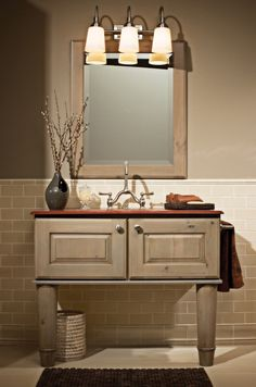 """Designer Bathroom Cabinetry shown with """"Nob Hill"""" door style in Knotty Alder with Driftwood/Coffee Glaze finish."""