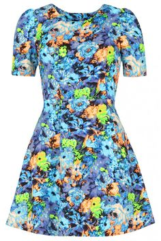 Love the hints of acid green and orange in this blue floral tea dress from Louche, Joy.