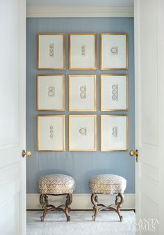 Decorating Hallways | Matching frames and similar prints anchored with two small benches make a statement in this hall. | Atlanta Homes & Lifestyles