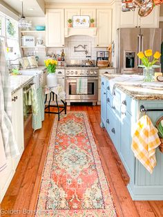 Spring decor in cottage style kitchen with farmhouse sink. Farm Kitchen Ideas, Farmhouse Style Kitchen, New Kitchen, Kitchen Dining, Cottage Kitchen Decor, Cozy Kitchen, Rugs For Kitchen, Country Cottage Kitchens, Colorful Kitchen Cabinets