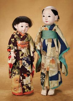 ". Early Japanese Paper Mache Ichimatsu Doll in Original Costume 14"" (36 cm.) Solid-domed paper mache swivel head on shoulder plate with gofu..."