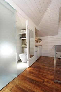 Great use of frosted glass, to make the bathroom less confining.