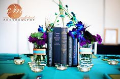 Old used book centerpieces! Could add peacock feathers instead of flowers.