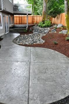 concrete patio, or at side of house for recyclable and garbage bins.
