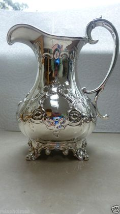 English, solid silver cream/milk jug by George John Richards of London, 1847  (195 grams / 6.37 troy ounces). Ebay £151.88