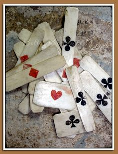 Game chips, or Jetons, these are very very old, very very thin, and very very French.    The pips are etched and coloured by hand, with an assortment of trèfles, carreaux, and cœurs, but no piques.