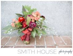 Organic Bridal Bouquet from Houston Wedding Florist Arteflora with touches of purple, orange and reds.