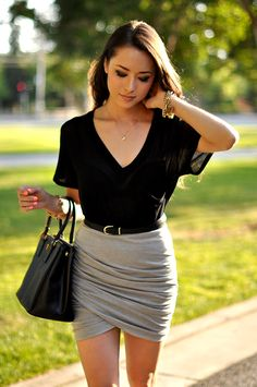 Jessica Norcal is wearing a black top from Dailylok, skirt from Minkpink and a bag from Prada