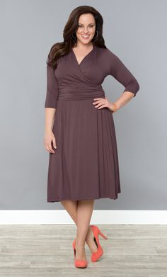 Our plus size Brenna Ballet Dress has a classic A-line skirt and faux wrap bodice that will have you feeling graceful and beautiful.  Keep the stunning simplicity of the dress with classic accessories and feminine waves. #KiyonnaPlusYou #Plussize #Kiyonna