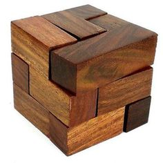 Handmade Cube Puzzle Handmade and Fair Trade. Finely handcrafted of sustainably harvested dark toned sheesham wood in India, this 3 inch by 3 inch by 3 inch is perfect for play and display.