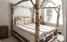 Birch Log Canopy Bed with scribed joinery.  Rustic and Elegant.