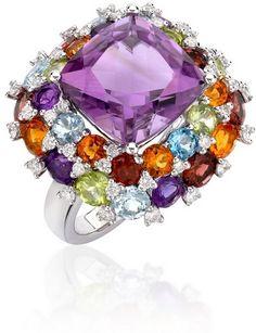 Kiki McDonough  /  coloured gemstones, a central cushion cut purple amethyst, with dazzling diamonds .
