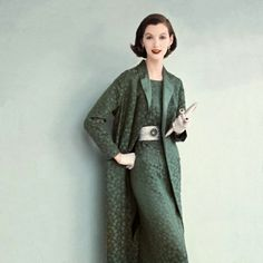 emerald brocade sheath with a matching full length coat (1955)  This looks like my mom. love the hair.