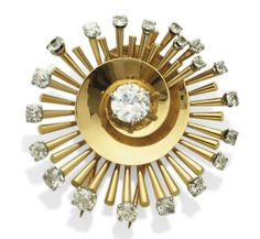 Gold and diamond clip brooch by Van Cleef & Arpels, circa 1960. [Can't you just see the blue eye shadow? I love it!]
