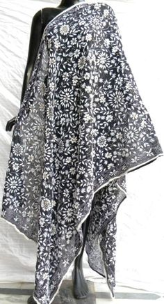 gorgeous monochromatic phulkari work georgette dupatta has a unique color combination, and heavy embroidery. It has been han embroidered in a vibrant colored floral pattern, with wool thread and sequins - See more at: http://giftpiper.com/Handembroidered-Phulkari-Work-Georgette-Dupatta-Black-White-id-259080.html#sthash.OD4SbcRd.dpuf