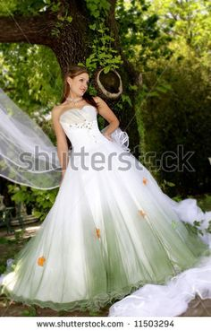 A bride standing under a tree in her wedding dress by Francois Etienne du Plessis, via ShutterStock
