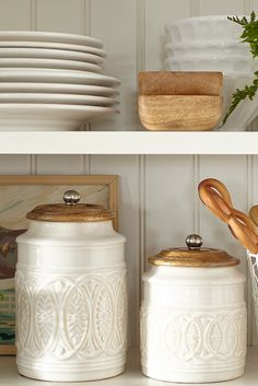 Whether you live in the city or in the country, Pier 1's Ivory Farmhouse Canisters are the cream of the crop. Plant them on a countertop and reap the compliments. Each features a carved mango wood lid with a handle.