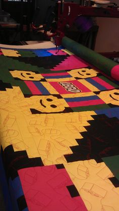 My friend Jessica designed this quilt and I quilted it using faux Lego blocks.