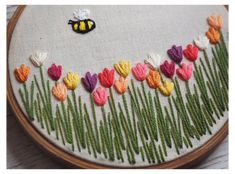 Your place to buy and sell all things handmade : Tulip Field Embroidery Hoop Art Tulip Embroidery Floral Hand Embroidery Videos, Embroidery Stitches Tutorial, Embroidery Flowers Pattern, Embroidery On Clothes, Embroidery Hoop Art, Hand Embroidery Designs, Floral Embroidery, Embroidery Jewelry, Embroidery For Beginners