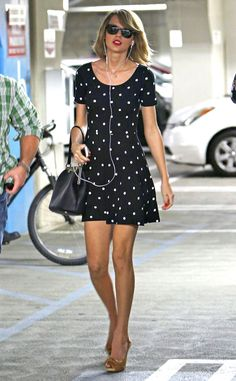 Spot On from Taylor Swift's Street Style  We love Taylor because she isn't above bargain shopping! She looked fabulous in this H&M polka dot dress that only cost $15.