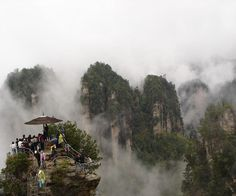Tianmen Mountain National Forest Park is at an elevation of meters and only 8 km away from the downtown of Zhangjiajie City. Zhangjiajie, Tianmen Mountain, Chinese Landscape Painting, Forest Park, National Forest, China, Wonders Of The World, The Good Place, National Parks
