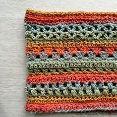 """Stitch sampler cowl http://mobiusgirldesign.weebly.com/blog  Yarn in sample is med 4 weight and 220 yds/200 m per skein February 2016 with Mirage loops & thread approx 1 1/2 skeins. Started with k hook for chain then J hook.  Changed the ending rows before the last two added row of DC row of HDC then SC then slip stitched the last row. 22 rows total. Did chain of 79 ended up 28""""X11"""""""