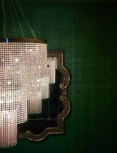 Chandelier & emerald walls
