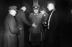 German Wehrmacht General Anton Dostler is tied to a stake before his execution by a firing squad in a stockade in Aversa, Italy, on December 1, 1945. The General, Commander of the 75th Army Corps, was sentenced to death by an United States Military Commission in Rome for having ordered the shooting of 15 unarmed American prisoners of war, in La Spezia, Italy, on March 26, 1944.