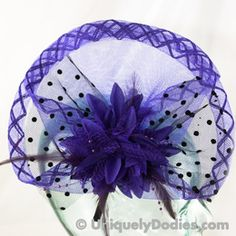 This outstanding purple fascinator is just right. With a lovely fan shape it measures 10 inches by 8 inches. The...